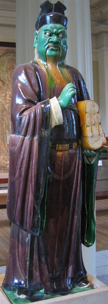 Stoneware figure from a judgment group with aubergine, green, ochre and straw gazes