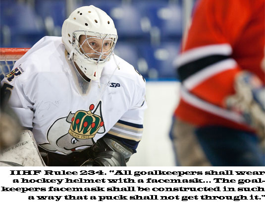 All goalkeepers shall wear a hockey helmet with a facemask ... constructed in such a way that a puck shall not get through it.
