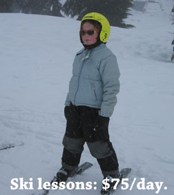 girl taking ski lessons